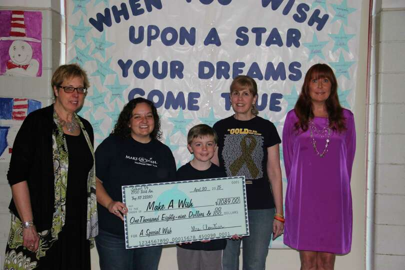 Troy School 14 students present a check to the Make-A-Wish Foundation for $1,100. Students raised th