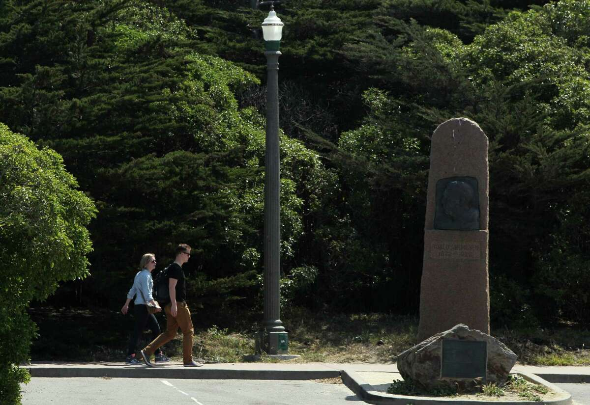 People walk past the Roald Amundsen monument near Beach Chalet in San Francisco. The Norwegian explorer's ship, the Gjoa, was beached in S.F. for more than 60 years. It is now gone and the lone remaining sign of its presence is the 10-foot-tall granite monument.