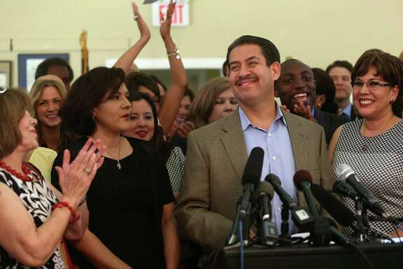 Supporters applaud Sheriff Adrian Garcia and his wife, Monica, right, as he announces his bid for mayor.