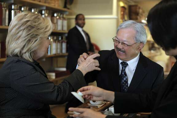 Hillary Rodham Clinton, left, Mayor Ed Lee, and Alice Luong, right, share tea at Red Blossom Tea Company in San Francisco on Wednesday. Former Secretary of State Hillary Rodham Clinton visited with Mayor Ed Lee to discuss problems specific to the city in San Francisco, Calif., on Wednesday, May 6, 2015.