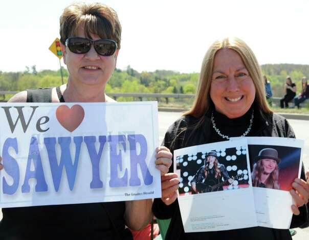 Excited fans Robin Wemple of Fonda, left, and Cynthia Otrupcak of Little Falls wait to see FultonvilleOs own Sawyer Fredericks in a parade outside the Fonda speedway to perform on Wednesday, May 6, 2015 in Fonda, N.Y. The 16-year-old singer/songwriter is one of the final six contestants on NBCOs show The Voice. (Lori Van Buren / Times Union) Photo: Lori Van Buren / 00031668A