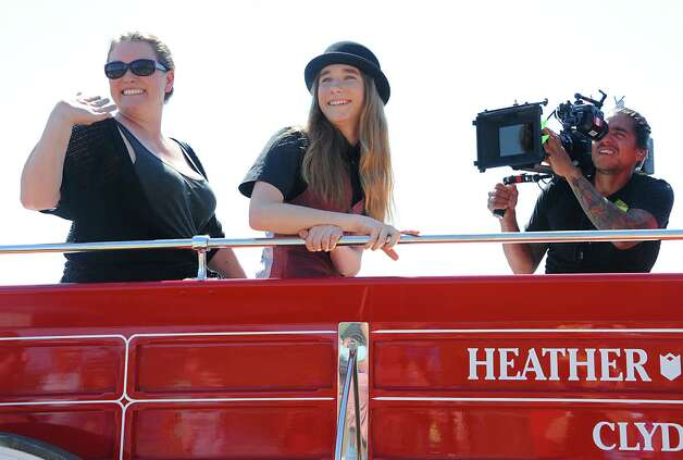 FultonvilleOs own Sawyer Fredericks and his mother Kirsten are pulled by horses in a parade heading to the Fonda Speedway on Wednesday, May 6, 2015 in Fonda, N.Y. The 16-year-old singer/songwriter is one of the final six contestants on NBCOs show The Voice. The cameraman on the right is from The Voice. (Lori Van Buren / Times Union) Photo: Lori Van Buren / 00031668A