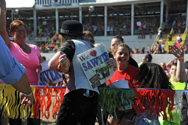 FultonvilleOs own Sawyer Fredericks arrives to the Fonda speedway to perform in front of excited fans on Wednesday, May 6, 2015 in Fonda, N.Y. The 16-year-old singer/songwriter is one of the final six contestants on NBCOs show The Voice. (Lori Van Buren / Times Union) Photo: Lori Van Buren / 00031668A