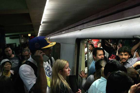 Commuters cram into the Pittsburg / Bay Point train at Montgomery BART station, Wednesday, May 6, 2015, in San Francisco, Calif. Trains were delayed all day because of a 10-inch section of broken rail between the Civic Center and 16th Street Mission stations.