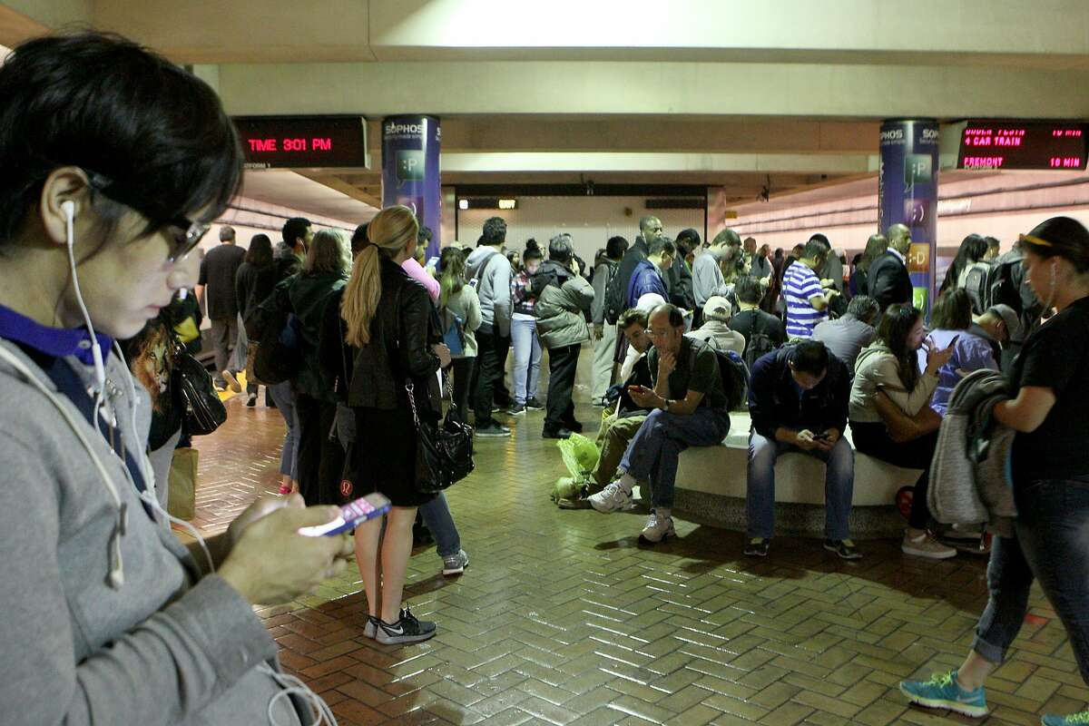 Hundreds of commuters wait to board trains at Montgomery BART station, Wednesday, May 6, 2015, in San Francisco, Calif. A computer malfunction Monday caused train delays of up to 15 minutes systemwide.