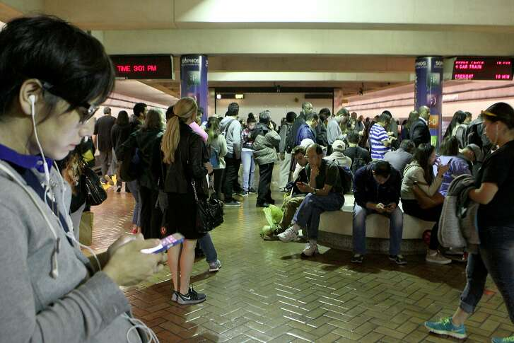Hundreds of commuters wait to board trains at Montgomery BART station, Wednesday, May 6, 2015, in San Francisco, Calif. Trains were delayed all day because of a 10-inch section of broken rail between the Civic Center and 16th Street Mission stations.