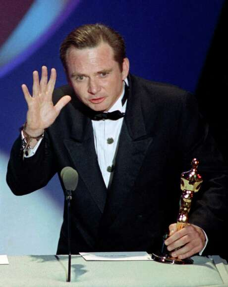 """Michael Blake accepts the Oscar for best adapted screenplay for """"Dances with Wolves"""" at the 63rd Annual Academy Awards in Los Angeles in 1991. The 69-year- old died Saturday in Tucson, Ariz., after a long battle with cancer. Photo: Associated Press / File Photo / AP"""