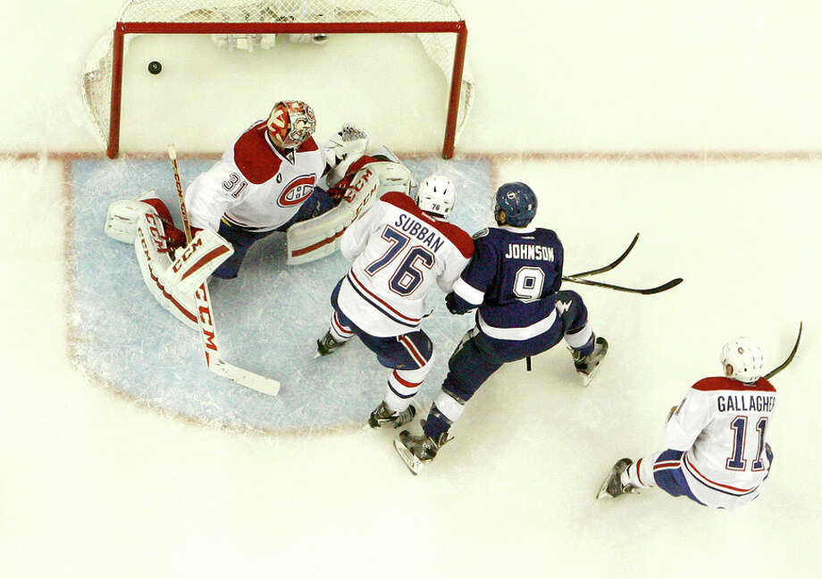 The Lightning's Tyler Johnson (9) scores the game-winning goal in the final seconds to beat the Canadiens in Game 3. Photo: Dirk Shadd / McClatchy-Tribune News Service / Tampa Bay Times