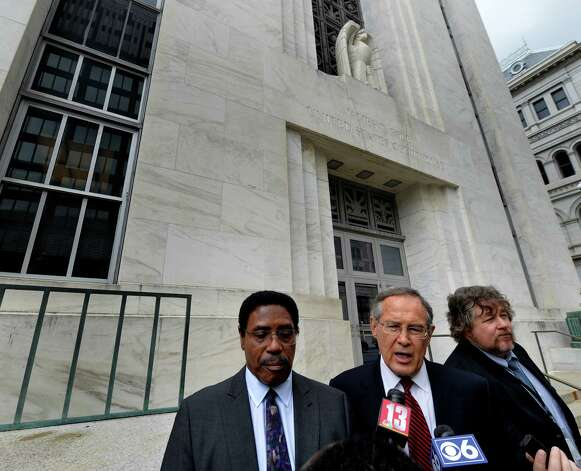 Assemblyman William Scarborough, left, listens as his attorney E. Stewart Jones, center, speaks after his appearance in federal court last October. (Skip Dickstein/Times Union) Photo: SKIP DICKSTEIN / 00028856A