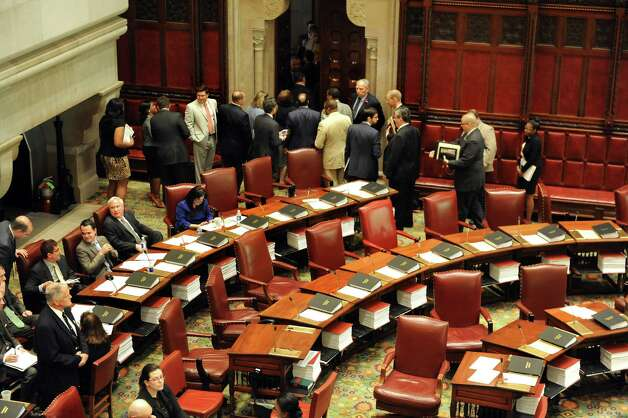 Senate Democrats walk out during session after demanding the removal of Senate Majority Leader Dean Skelos on Wednesday, May 6, 2015, at the Capitol in Albany, N.Y. (Cindy Schultz / Times Union) Photo: Cindy Schultz