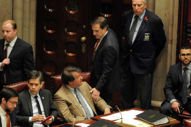 Senator Michael Gianaris, center, garners support for a mass exit as Senate Democrats walk out of session on Wednesday, May 6, 2015, at the Capitol in Albany, N.Y. They were demanding the removal of Senate Majority Leader Dean Skelos. (Cindy Schultz / Times Union) Photo: Cindy Schultz