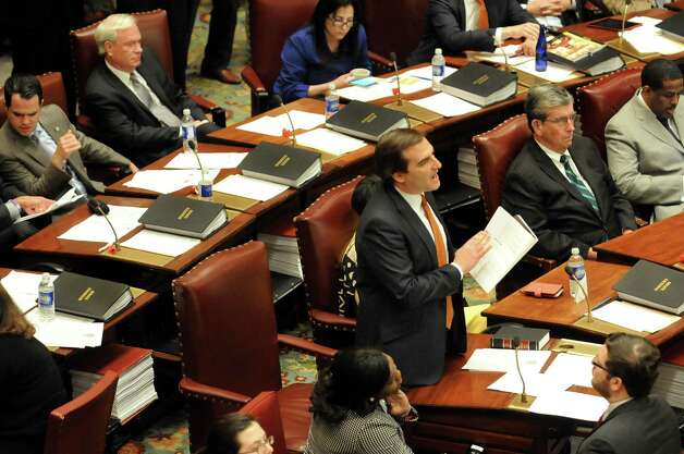 Senator Michael Gianaris, center, voices his demands for the removal of Senate Majority Leader Dean Skelos on Wednesday, May 6, 2015, at the Capitol in Albany, N.Y. (Cindy Schultz / Times Union) Photo: Cindy Schultz