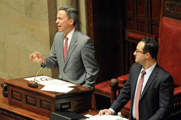 Presiding over the chamber, Sen. Jack Martins, left, tries to silence the Senate Democrats during session on Wednesday, May 6, 2015, at the Capitol in Albany, N.Y. (Cindy Schultz / Times Union) Photo: Cindy Schultz