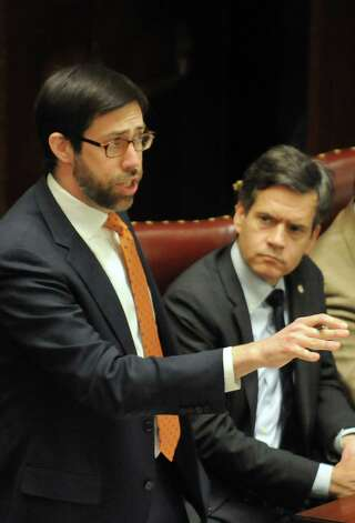 Sen. Daniel Squadron, left, voices demands for the removal of Senate Majority Leader Dean Skelos during session on Wednesday, May 6, 2015, at the Capitol in Albany, N.Y. (Cindy Schultz / Times Union) Photo: Cindy Schultz