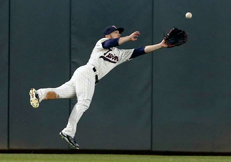 Minnesota Twins center fielder Shane Robinson makes a diving catch for the final out of the baseball game on a fly ball off the bat of Oakland Athletics catcher Josh Phegley, Wednesday, May 6, 2015, in Minneapolis. The Twins won 13-0. (AP Photo/Jim Mone) Photo: Jim Mone / Associated Press / AP