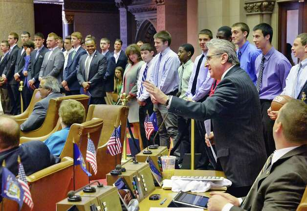 Assemblyman James Tedisco, center gesturing, introduces the Shen and Scotia boys' basketball teams as they're honored on the floor of the NYS Assembly for their state championships Wednesday May 6, 2015 at the Capitol in Albany, NY. (John Carl D'Annibale / Times Union) Photo: John Carl D'Annibale / 00031731A