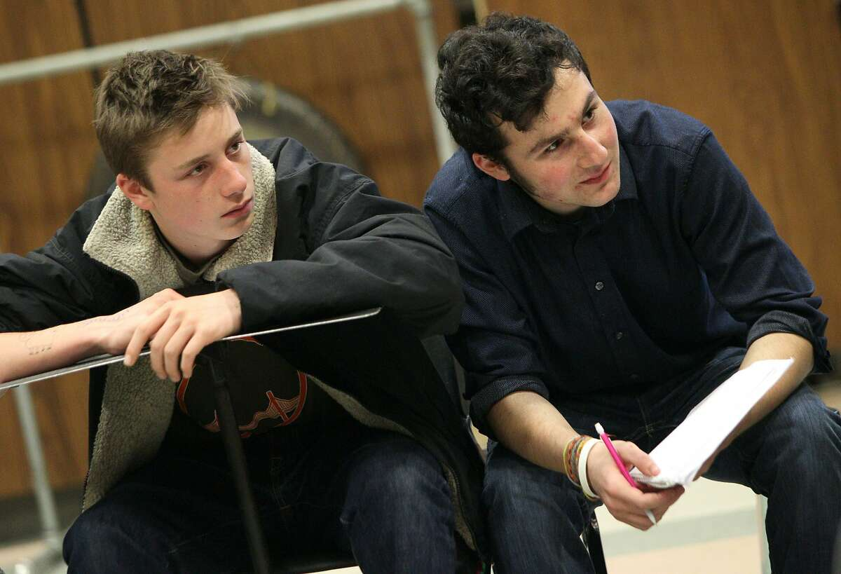 Sixteen-year-olds Myles Ehline, left, and Leo Polonsky listen in during their cult survey class at the Ruth Asawa San Francisco School of the Arts, Wednesday, May 6, 2015, in San Francisco, Calif. The S.F. school board is considering changes to the school enrollment because there are too many out-of-towners and not enough diversity.