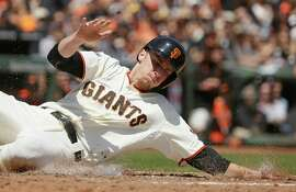 San Francisco Giants' Matt Duffy scores the Giants' first run after Nori Aoki singled on a line drive to center field in the third inning of their baseball game against the San Diego Padres Wednesday, May 6, 2015, in San Francisco. (AP Photo/Eric Risberg)