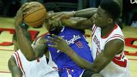 Rockets rookie center Clint Capela, right, mixes it up with the Clippers' DeAndre Jordan during the second quarter Wednesday night.