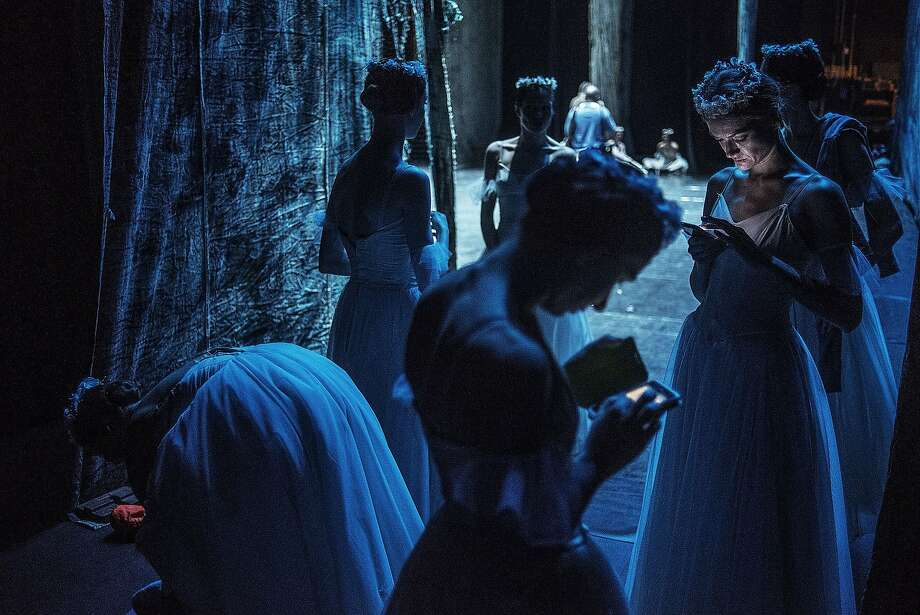 """Ballerinas take a break during a """"Giselle"""" dress rehearsal before the first official show on May 6, 2015 in Johannesburg, as the St. Petersburg Ballet Theater kicks off the South African leg of the global season. Photo: Mujahid Safodien, AFP / Getty Images"""