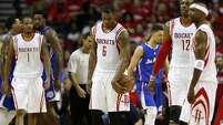 Houston Rockets forward Trevor Ariza (1),  forward Terrence Jones (6), center Dwight Howard (12) and guard Jason Terry (31) walk up the court during the third quarter of Game 2 of the NBA Western Conference semifinals against the Los Angeles Clippers  at Toyota Center Wednesday, May 6, 2015, in Houston. ( James Nielsen / Houston Chronicle )