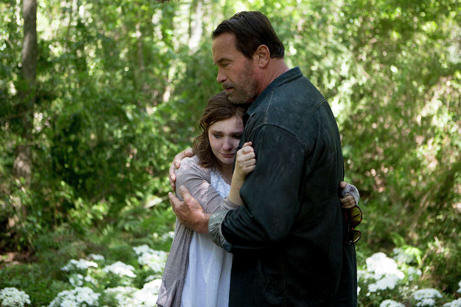 "Arnold Scharzenegger gives one of the best performances of his long career as the soft-spoken farmer facing his daughter's inevitable decline in ""Maggie"" with Abigail Breslin. Photo: HANDOUT / Washington Post / THE WASHINGTON POST"
