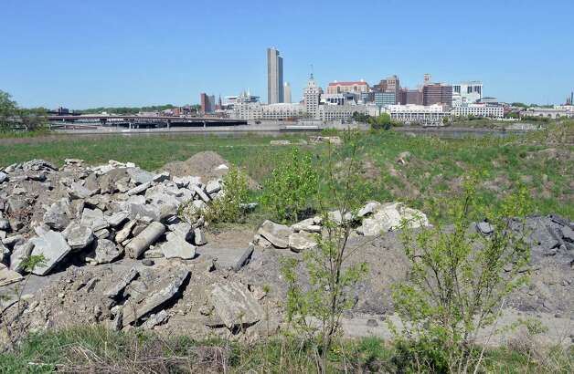 The Albany skyline visible from the vacant waterfront site where the Rensselaer High School once stood Thursday May 7, 2015 in Rensselaer, NY.  (John Carl D'Annibale / Times Union) Photo: John Carl D'Annibale