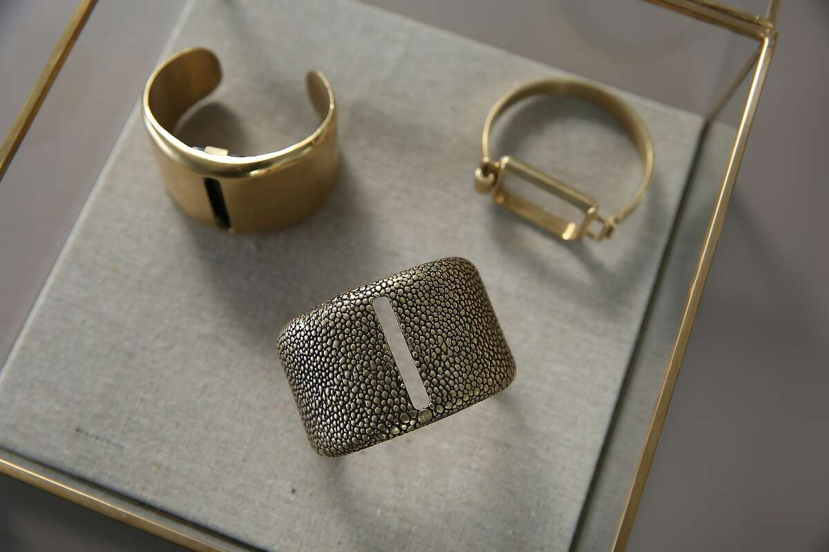 Some of the jewelry from CEO and founder Deepa Sood of Cuff seen at her office in San Francisco, California, on Wednesday, May 6, 2015. Cuff is a module worn as jewelry that alerts to phone messages and texts, does activity tracking, and has a safety feature.