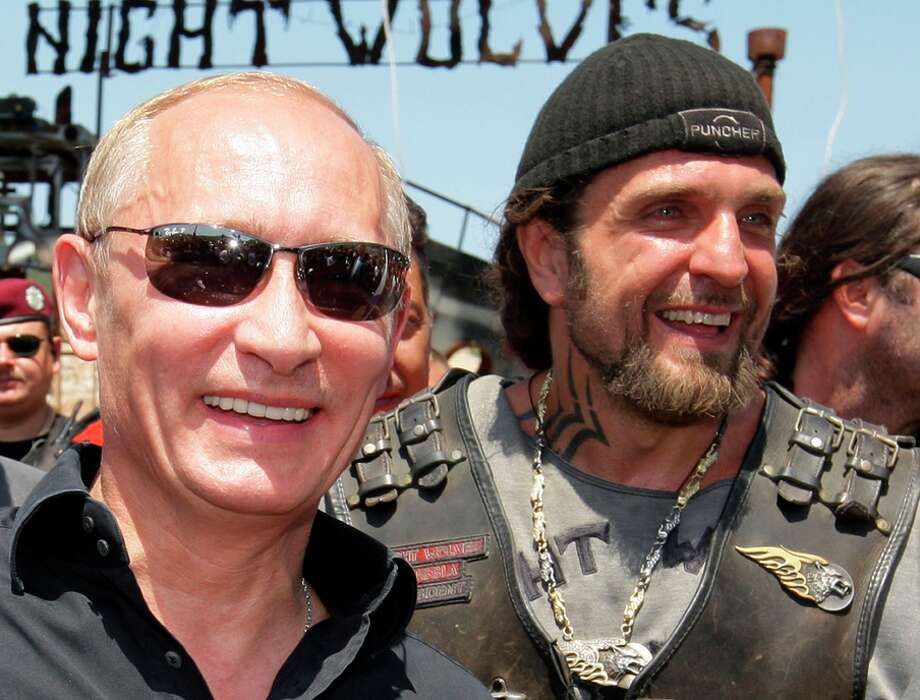 Vladimir Putin (left) then Russian prime minister, meets in Crimea in 2010 with Russian bikers called the Night Wolves. Photo: ALEXEY DRUZHININ / AFP/Getty Images / AFP