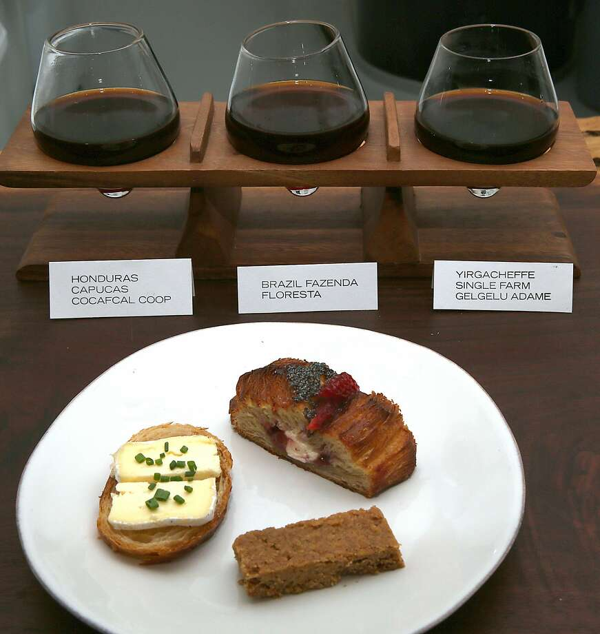 Clockwise from left--Cowgirl Creamery Mt. Tam cheese paired with Yirgacheffe single farm Gelgelu Adame, strawberry danish paired with Brazil Fazenda Floresta, brown butter shortbread paired with Honduras Capucas Cocafcal Coop at Hearth Coffee Roasters in San Francisco, California, on Wednesday, May 6, 2015. Photo: Liz Hafalia, The Chronicle