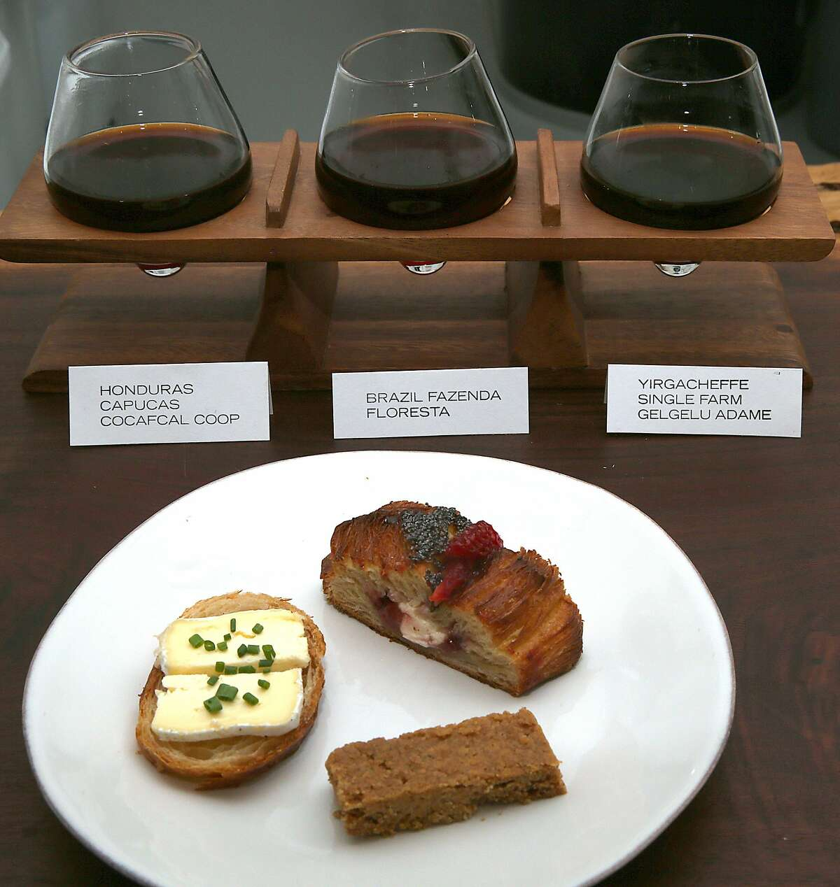Clockwise from left--Cowgirl Creamery Mt. Tam cheese paired with Yirgacheffe single farm Gelgelu Adame, strawberry danish paired with Brazil Fazenda Floresta, brown butter shortbread paired with Honduras Capucas Cocafcal Coop at Hearth Coffee Roasters in San Francisco, California, on Wednesday, May 6, 2015.