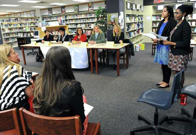 """Co-chairs Anum Hussain, second from right, and Amber McKay, right, introduce a panel of prominent woman leaders in the community at the annual """"Women in Leadership"""" event put on by Girls Take Charge at Shaker Junior High School on Friday, April 24, 2015 in Colonie, N.Y. The panel included, from left, Paula Mahan, Town of Colonie supervisor, Lisa Travis, director at the Town of Colonie, Anne McEntee, President & CEO Renewables at GE Power & Water, Ann Anderson, professor of mechanical engineering at Union College and Ashley Miller, sports journalist at WNYT.  (Lori Van Buren / Times Union) Photo: Lori Van Buren / 00031547A"""