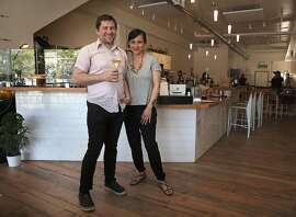 James Kafader (left) and his wife Ariana Akabar (right) show Hearth Coffee Roasters in San Francisco, California, on Wednesday, May 6, 2015.