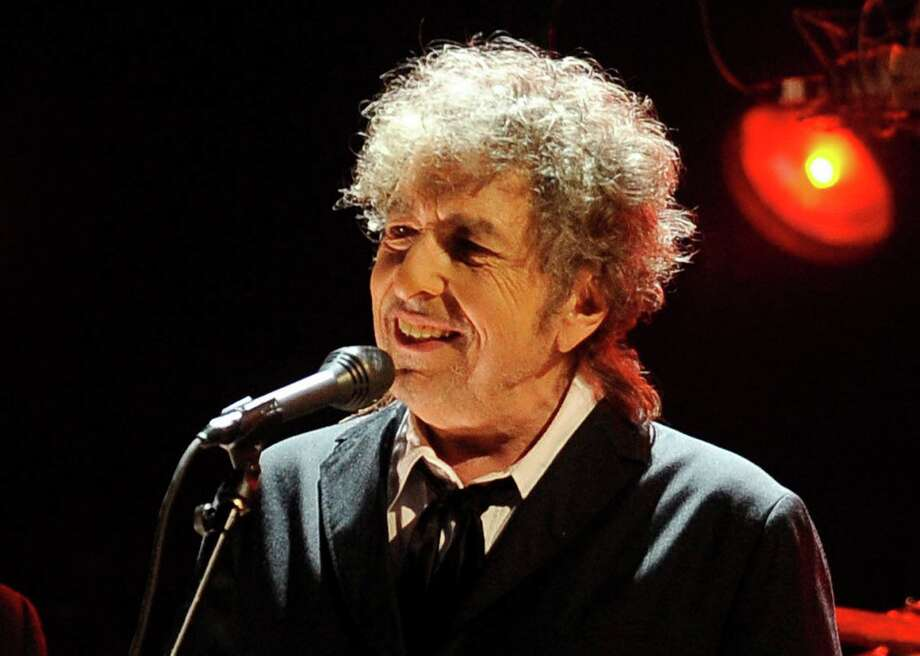 "FILE - In this Jan. 12, 2012 file photo, Bob Dylan performs in Los Angeles. One of the most popular songs of all time, Dylan's ""Like a Rolling Stone,"" could bring between $1 million and $2 million at auction. A working draft of the finished song in Dylan's own hand is being offered by Sotheby's on Tuesday, June 24, 2014. (AP Photo/Chris Pizzello, File) Photo: Chris Pizzello, STF / Associated Press / AP"