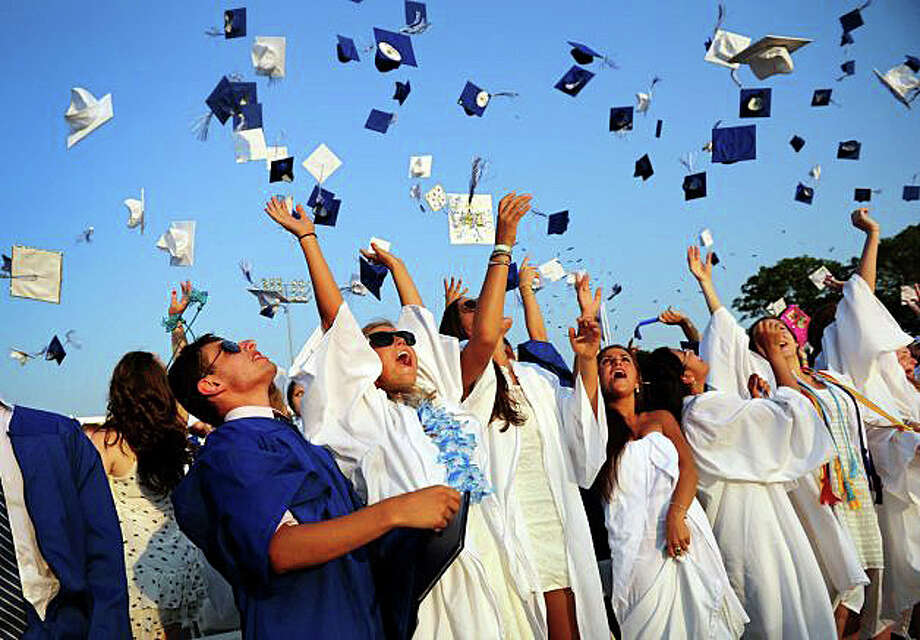 The senior class of Fairfield Ludlowe High School has voted to keep blue graduation gowns for boys and white for girls. Photo: File Photo / Fairfield Citizen