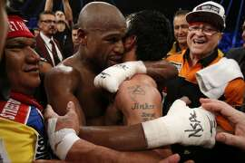 Floyd Mayweather Jr., hugs Manny Pacquiao after defeating Pacquiao in their welterweight unification bout on May 2, 2015 at the MGM Grand Garden Arena in Las Vegas, Nevada. AFP PHOTO / JOHN GURZINKSIJOHN GURZINSKI/AFP/Getty Images