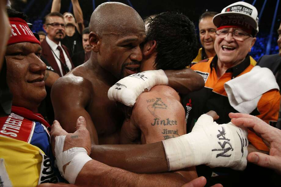 Floyd Mayweather Jr., hugs Manny Pacquiao after defeating Pacquiao in their welterweight unification bout on May 2, 2015 at the MGM Grand Garden Arena in Las Vegas, Nevada. AFP PHOTO / JOHN GURZINKSIJOHN GURZINSKI/AFP/Getty Images Photo: John Gurzinski, AFP / Getty Images