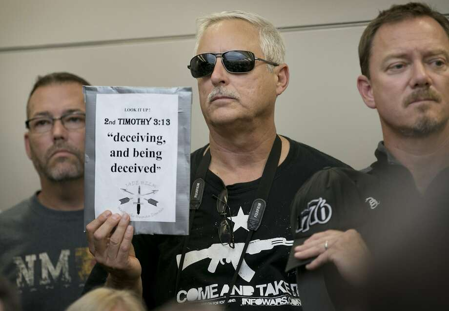 Bob Welch holds a sign at a public hearing about the Jade Helm 15 military training exercise in Bastrop, Texas, Monday April 27, 2015. (Jay Janner/Austin American-Statesman via AP)  AUSTIN CHRONICLE OUT, COMMUNITY IMPACT OUT, INTERNET AND TV MUST CREDIT PHOTOGRAPHER AND STATESMAN.COM, MAGS OUT Photo: Jay Janner, Associated Press
