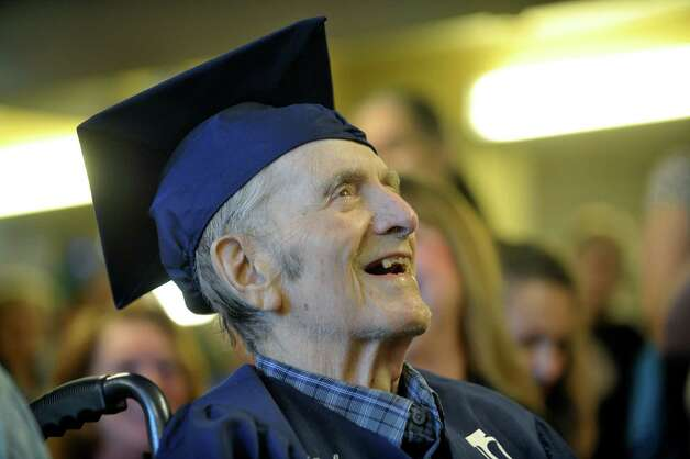 Navy veteran Ken Kross, an 87-year-old cancer patient, laughs as the principal of Rensselaer High School tells him she looked up his grades, during a diploma ceremony at at Van Rensselaer Heights apartments on Thursday, May 7, 2015, in Rensselaer, N.Y.  Kross dropped out of Rensselaer High School more than 70 years ago and never received a diploma.  Kross had enlist in the military and serve during World War II. (Paul Buckowski / Times Union) Photo: PAUL BUCKOWSKI / 00031756A