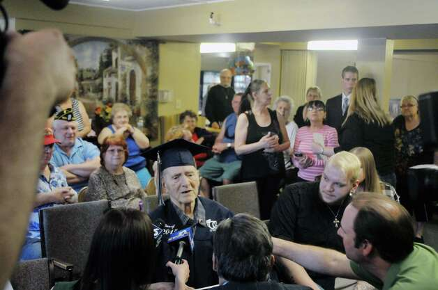 Navy veteran Ken Kross, an 87-year-old cancer patient, talks to members of the media during a diploma ceremony at his residence at Van Rensselaer Heights apartments on Thursday, May 7, 2015, in Rensselaer, N.Y.  Kross dropped out of Rensselaer High School more than 70 years ago and never received a diploma.  Kross had enlist in the military and serve during World War II. (Paul Buckowski / Times Union) Photo: PAUL BUCKOWSKI / 00031756A
