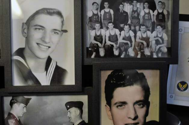Old photographs of Navy veteran Ken Kross, an 87-year-old cancer patient, are on display during a diploma ceremony at his residence at Van Rensselaer Heights apartments on Thursday, May 7, 2015, in Rensselaer, N.Y.  Kross dropped out of Rensselaer High School more than 70 years ago and never received a diploma.  Kross had enlist in the military and serve during World War II. (Paul Buckowski / Times Union) Photo: PAUL BUCKOWSKI / 00031756A