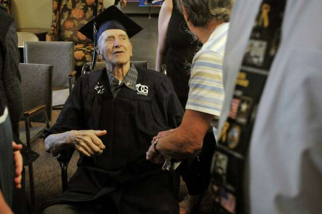 Navy veteran Ken Kross, an 87-year-old cancer patient, talks with guests during a diploma ceremony at his residence at Van Rensselaer Heights apartments on Thursday, May 7, 2015, in Rensselaer, N.Y.  Kross dropped out of Rensselaer High School more than 70 years ago and never received a diploma.  Kross had enlist in the military and serve during World War II. (Paul Buckowski / Times Union) Photo: PAUL BUCKOWSKI / 00031756A