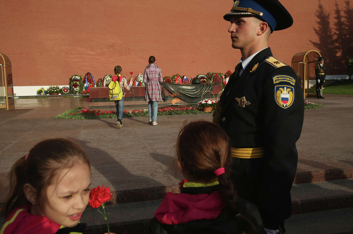 Children place flowers at the Tomb of the Unknown Soldier to mark the 70th anniversary of the victory over Nazi Germany.