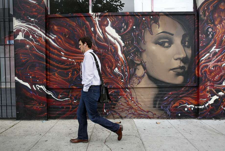 A pedestrian walks past the outside of StartupHouse on 934 Howard St. May 7, 2015 where Rand Paul will be setting up his San Francisco office. Photo: Leah Millis, The Chronicle