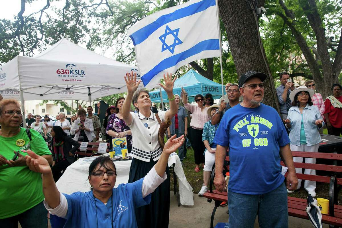 A crowd sings during a worship song during the National Day of Prayer Thursday May 7, 2015 on the steps of City Hall. This is the 64th annual prayer, and the 30th consecutive year that San Antonio has participated. The National Day of Prayer was created in 1952 by President Harry Truman and signed into law by both Houses of Congress. In 1988 President Ronald Reagan signed a resolution amending the law making the National Day of Prayer to always be on the first Thursday of May each year. Organized by the San Antonio National Day of Prayer planning committee, speakers included Mayor Ivy Taylor, San Antonio Chief of Police Anthony Trevino, and local pastors who prayed for the city, nation and family.