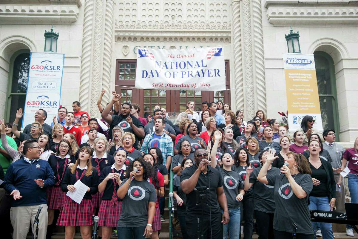 Members of 210 Church and a City choir start the day with worship songs during the National Day of Prayer Thursday May 7, 2015 on the steps of City Hall. This is the 64th annual prayer, and the 30th consecutive year that San Antonio has participated. The National Day of Prayer was created in 1952 by President Harry Truman and signed into law by both Houses of Congress. In 1988 President Ronald Reagan signed a resolution amending the law making the National Day of Prayer to always be on the first Thursday of May each year. Organized by the San Antonio National Day of Prayer planning committee, speakers included Mayor Ivy Taylor, San Antonio Chief of Police Anthony Trevino, and local pastors who prayed for the city, nation and family.