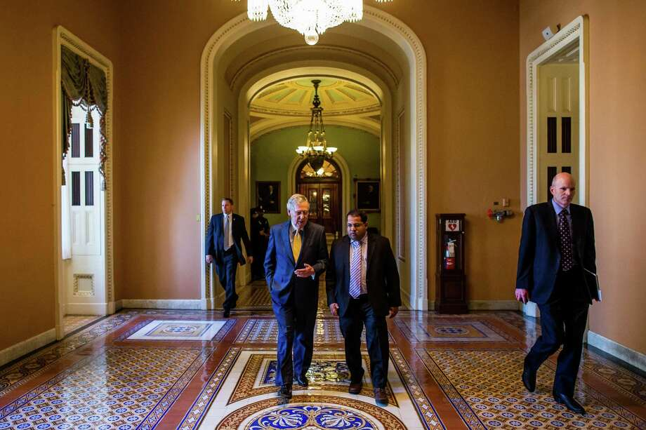 Senate Majority Leader Mitch McConnell walks towards his office on Capitol Hill in Washington, May 7, 2015. A bill that would give Congress a voice in any nuclear agreement between world powers will face its final vote Thursday afternoon after Republican infighting prevented a debate of further changes to the bill. Photo: ZACH GIBSON / New York Times / NYTNS