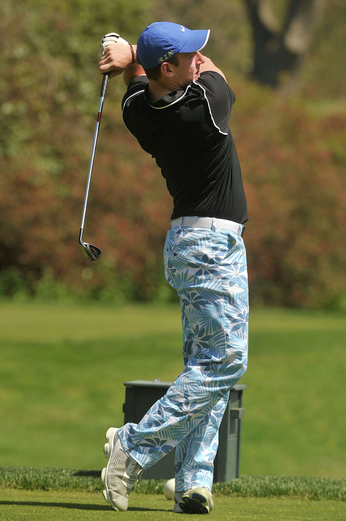 Westhill's Matt Kubli tees off during the City High School golf championship at Woodway Country Club in Darien, Conn., on Thursday, May7, 2015.
