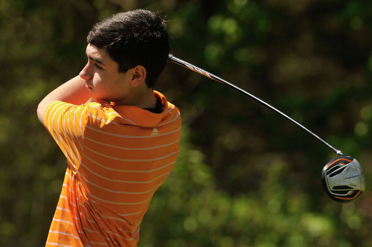 Stamford's Bryan Schwartz follows through while teeing off during the City High School golf championship at Woodway Country Club in Darien, Conn., on Thursday, May7, 2015.