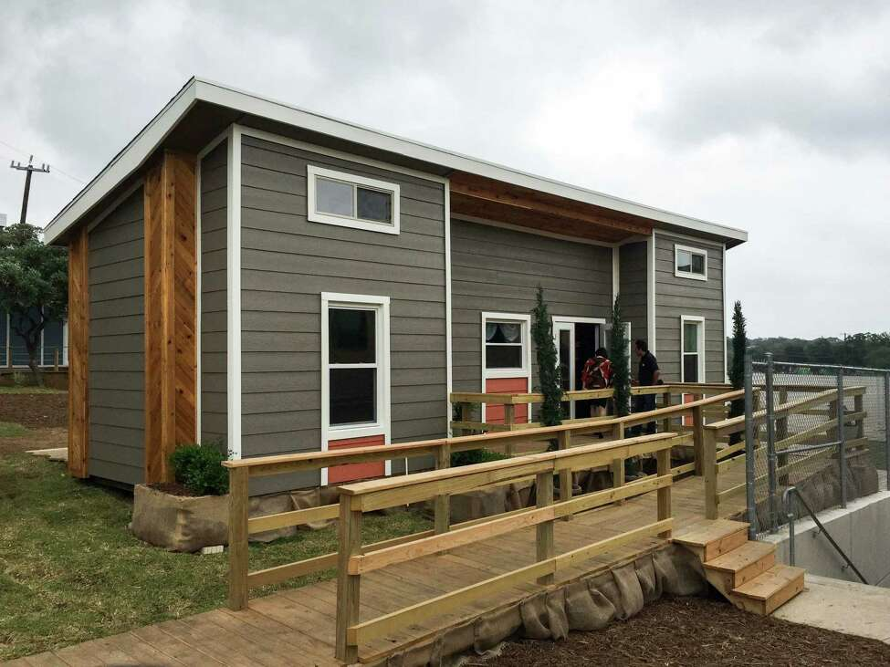 This tiny home's theme, ADA/Disability, provides adjustments to a typical home setup by allowing for larger entryways for wheelchairs, lower positioning for light switches and other changes.